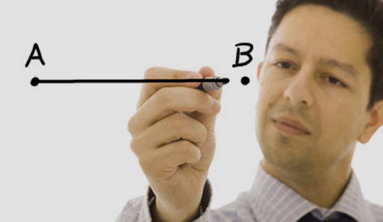 businessman drawing a line from point A to point B (selective focus)